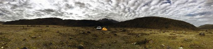 Camping in the Mountains panoramic. Steepes and volcano scenery. Yellow tent in the mountains of Ecuadorian highlands. Taken at about 4000 mts above sea level Stock Photos