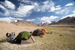 Camping in the Mountains of Tajikistan. Three tents, camping at 4,000 metres of altitude while cycling the Pamir Highway Royalty Free Stock Photos