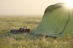 Camping in mountains. Tent in mountains in a fog morning Stock Image