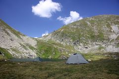 Camping in the mountains. Tents in Fagaras Mountains, Romania, near Capra Lake Stock Photography