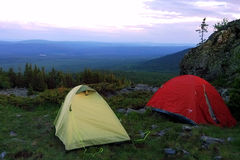 The camping in mountains with tents. Travel to Ural mountains, Russia. The camping in mountains with tents Stock Images