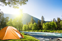 Camping in mountains. Tourist tent in forest camp Stock Images