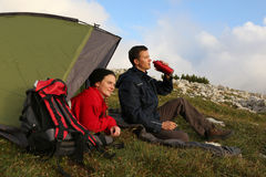 Camping in the mountains. Two young people camping in the mountains Royalty Free Stock Image