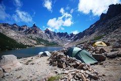 Camping near a blue lake Stock Photo