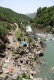 Camping near waterfall Stock Photo