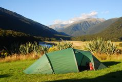 Camping in New Zealand. A tent set up at a DOC campground near the Haast Pass on New Zealand's South Island Stock Photo