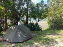 Camping next to the beach in the shadow stock photo