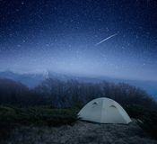 Camping at night in the mountains. Tourist tent under the stars. Camping at night in the mountains Stock Photos