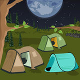 Camping at night with tents under the night sky with a lot of stars and big moon Stock Images