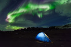 Camping in the north with the northern lights overhead. Aurora Borealis Stock Photos