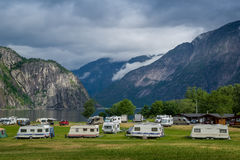 Camping at north sea fjord with mountains background, Norway. Royalty Free Stock Images