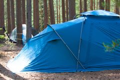Camping outdoor with  tent in woods in summer Royalty Free Stock Image