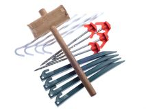 Camping pegs and wooden mallet Stock Images