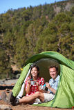 Camping people - couple eating in tent happy Royalty Free Stock Photography