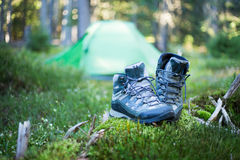 Camping people putting on hiking shoes by tent. Camping  putting on hiking shoes by tent Stock Photography