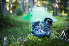 Camping people putting on hiking shoes by tent. Camping  putting on hiking shoes by tent Royalty Free Stock Image