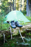 Camping people putting on hiking shoes by tent. Camping  putting on hiking shoes by tent Royalty Free Stock Photos