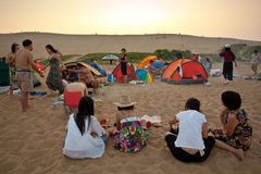 Camping picnic. Visitors are camping and picnic in beach at sunset, in Emerald Isle[Feicuidao]  Hebei China Royalty Free Stock Photo
