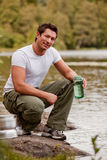 Camping Portrait Man. A man fetching water on a camping trip royalty free stock photography