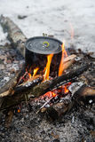A camping pot on a campfire in the winter Royalty Free Stock Photography