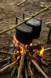 Camping pots. Cooking by using camping pot and bonfire Royalty Free Stock Photography
