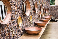 Camping public toilets with hand made sinks and mirrors Stock Image