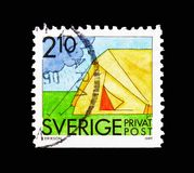 Camping, Rebate stamps - Summer Activities serie, circa 1989. MOSCOW, RUSSIA - AUGUST 18, 2018: A stamp printed in Sweden shows Camping, Rebate stamps - Summer stock image