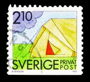 Camping, Rebate stamps - Summer Activities serie, circa 1989. MOSCOW, RUSSIA - FEBRUARY 10, 2019: A stamp printed in Sweden shows Camping, Rebate stamps - Summer stock photos