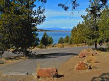 Camping By the Reservoir. Haystack Reservoir and Campground - Crooked River National Grassland - near Culver, OR - Mt. Jefferson in the distance Stock Image