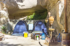 Camping in the rocks. Of Cappadocia. In the center of Red Rose Valley. In the valley of Red rose tourists build a primitive place for camping. This is one of stock images