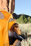 Camping In the Rocky Mountains. Young Woman Camping In the Rocky Mountains Stock Photos