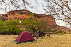 Camping beside scenic cliffs and landscape at the majestic Golden Gate Highlands National Park, famous travel destination in South Stock Photos