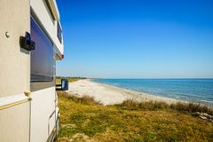 Camping by the sea with motorhome Stock Photos