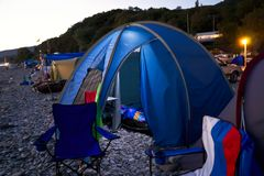 Camping by the sea at night Stock Images