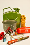 Camping set. Gasoline tank,multifuel stove,lighter,filter funnel,life rope and bowie knife are camping accessories for trekking in the wild Royalty Free Stock Photography