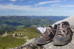 Camping with the shoes in the mountains against the blue sky. Camping with the shoes in the mountains on a sunny day Stock Image