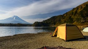 Camping at Shoji lake with mt. Fuji. Yellow tent at Shoji lake with Mt. Fuji view,Yamanashi,  Japan. 1 of 5 Fujisan lakes with many recreation activities such as Stock Images