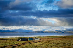 Camping on the shore of Lake Manasarovar in Tibet Stock Photo