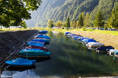 Camping on the shore of the montain lake Klontalersee. Boats on Stock Photography