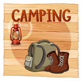 Camping sign with lantern and backpack Stock Photos