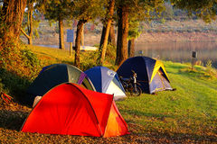 Camping site. Tents in camping site at lake side at sunset stock photography