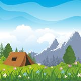 Camping Site with beautiful nature landscape. Tents are on nature landscape, green grass, flower, trees and mountain with blue sky background Royalty Free Stock Photo