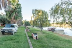 Camping sites at Sakkie se Arkie in Upington. UPINGTON, SOUTH AFRICA - JUNE 11, 2017: Camping sites at Sakkie se Arkie, a holiday resort next to the Orange River royalty free stock image