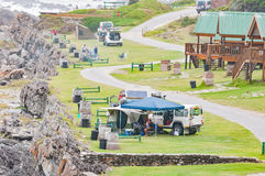 Camping sites at Storms River Mouth. STORMS RIVER MOUTH, SOUTH AFRICA - MARCH 1, 2016:  Unidentified tourists at camping sites next to chalets at Storms River Stock Images