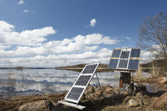Camping solar panels on the shore. Early spring Royalty Free Stock Photography