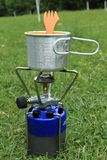 Camping stove in grass. With baby food stock photo