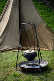 Camping. Summer camping view with an old tent and pot on campfire royalty free stock photo