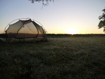 Camping sunrise. Tent and sunrise on the Okavango delta in Botswana stock photo