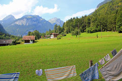 Camping in Switzerland. View at the mountains and meadow royalty free stock photography