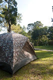 Camping Tent. Camouflage Camping Tent in Campsite Stock Photo